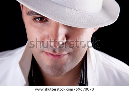 Portrait of a man with his white hat, isolated on black. Studio shot - stock photo