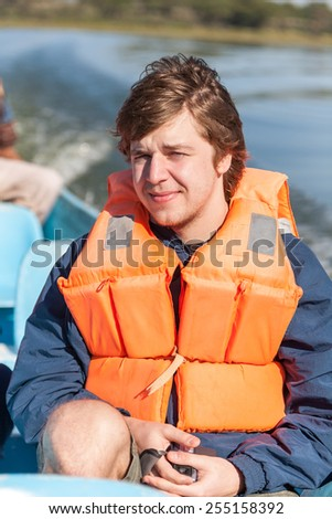 Portrait of a man with  life jacket. rafting. - stock photo