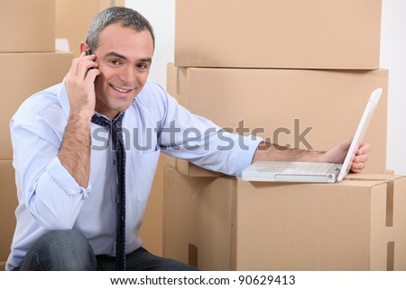 portrait of a man with moving boxes - stock photo