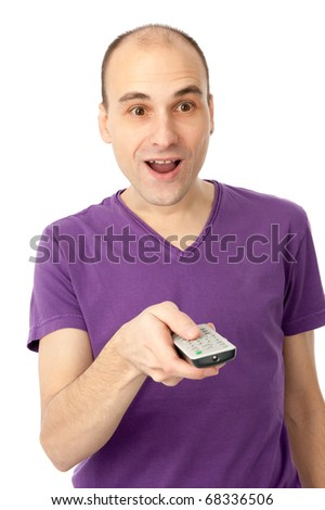 Portrait of a man with remote control watching television - stock photo