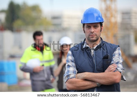 Portrait of a man with safety helmet crossing his arms - stock photo