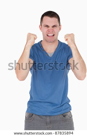 Portrait of a man with the fists up against a white background