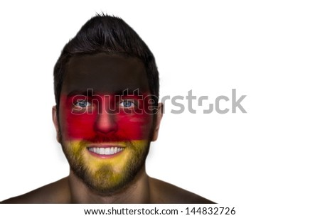Portrait of a man with the flag of the Germany painted on his face - stock photo