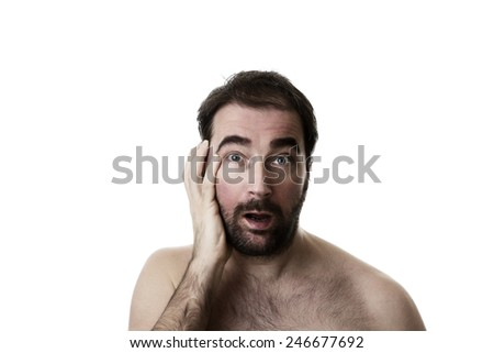 Portrait of a man with two weeks of facial hair growth - stock photo