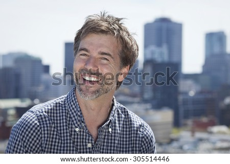Portrait Of A Mature Active Man Smiling In a city - stock photo
