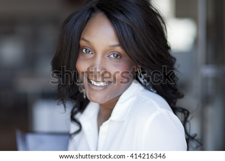 Portrait Of A Mature Black Woman Smiling At Home - stock photo