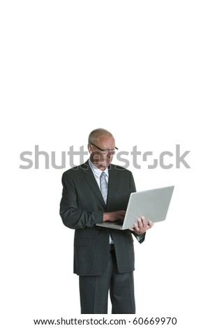 portrait of a mature business man looking at laptop isolated on white background - stock photo