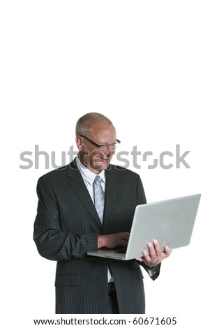 portrait of a mature business man looking at laptop isolated on white background