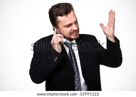 Portrait of a mature business man screaming in his cellphone over white - stock photo