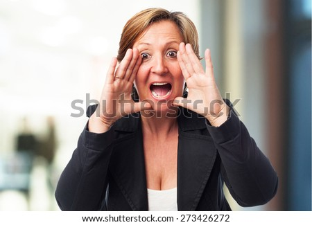 portrait of a mature business woman shouting - stock photo