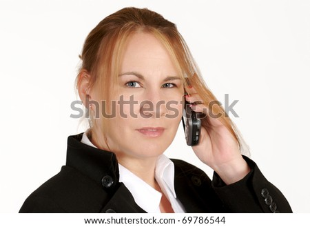 portrait of a mature business woman talking on a cell phone - stock photo