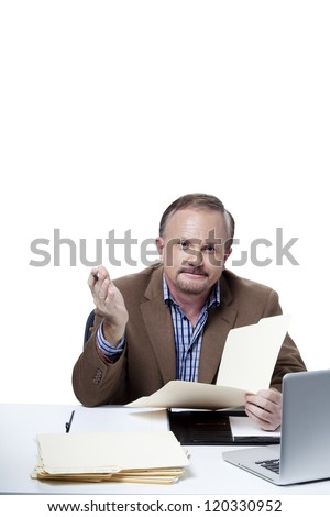 Portrait of a mature businessman holding a file at work over white background
