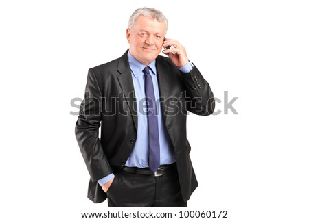 Portrait of a mature businessman talking on a phone isolated on white background - stock photo