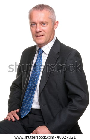 Portrait of a mature businessman wearing a gray suit with blue tie, isolated on a white background. - stock photo