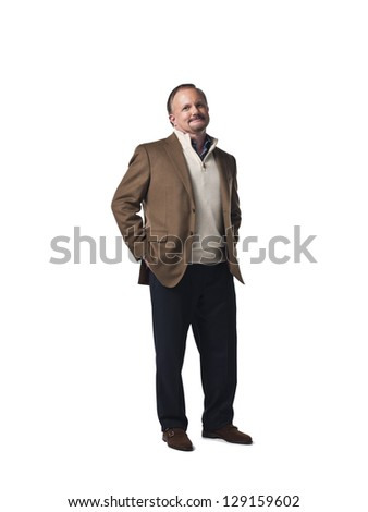 Portrait of a mature businessman with hands in pocket over white background