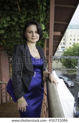 Portrait of a mature businesswoman in a blue evening dress.  - stock photo