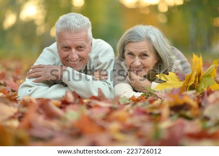 Portrait of a mature couple in the autumn park