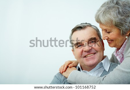 Portrait of a mature embracing couple - stock photo