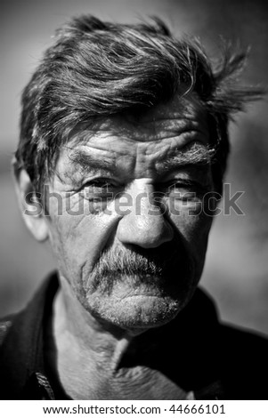 Portrait of a mature man. BW photo.