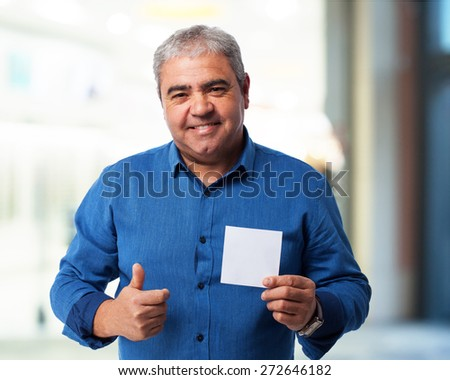 portrait of a mature man holding a paper - stock photo