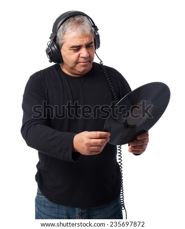portrait of a mature man listening to music and holding a vinyl - stock photo