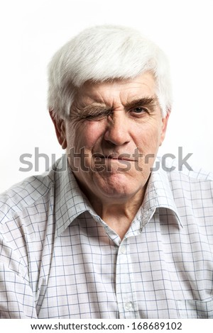 Portrait of a mature man making faces. Isolated on white background  - stock photo