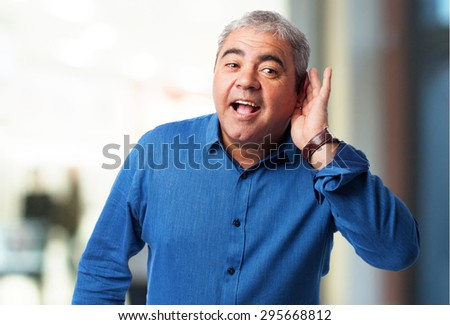 portrait of a mature man trying to hear something - stock photo