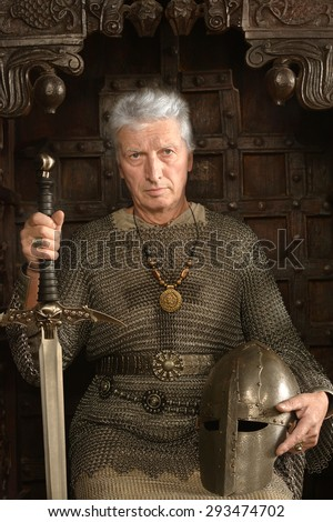 portrait of a mature medieval knight on the throne - stock photo