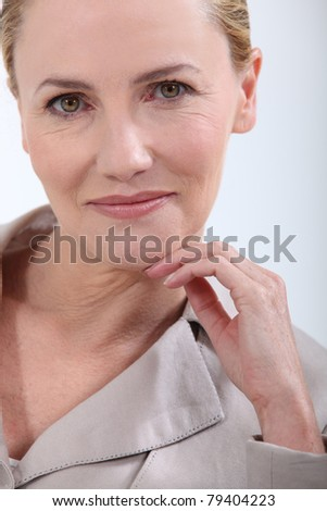 Portrait of a mature woman - stock photo