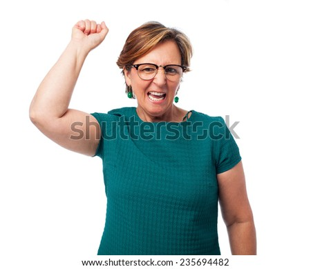 portrait of a mature woman doing a winner gesture - stock photo