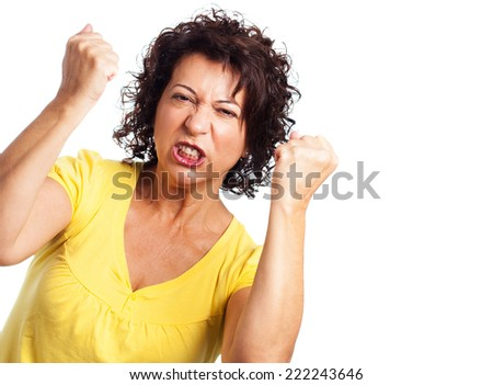 portrait of a mature woman doing a winner gesture on a white background