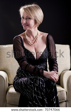 Portrait of a mature woman in evening gown - stock photo