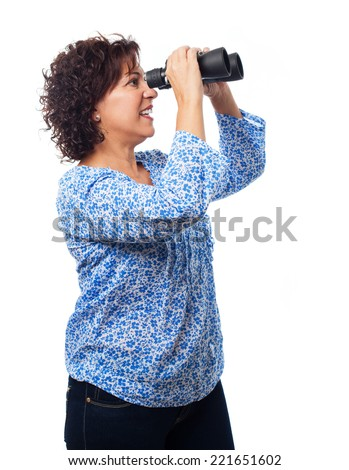 portrait of a mature woman looking through the binoculars on a white background - stock photo