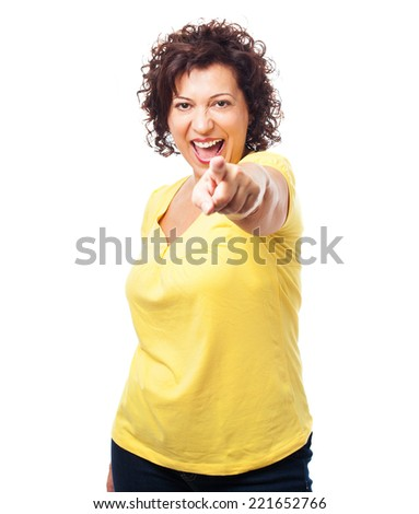 portrait of a mature woman pointing with her finger - stock photo