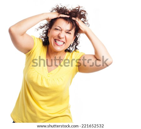 portrait of a mature woman pulling her hair on a white background - stock photo