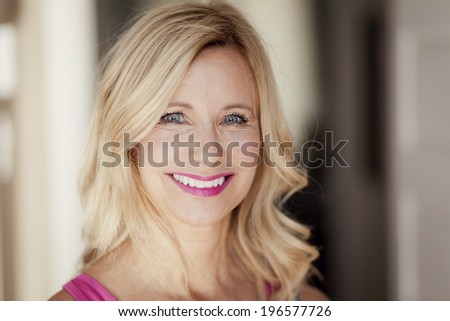 Portrait Of A Mature Woman Smiling - stock photo