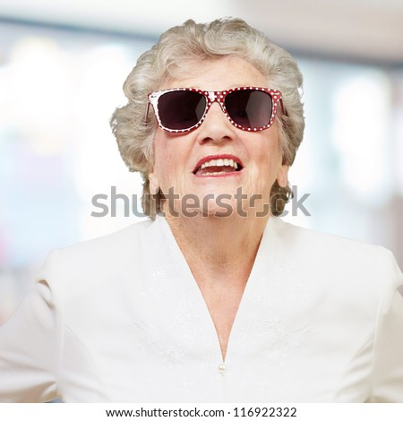 Portrait Of A Mature Woman While Giving Pose, Indoor - stock photo