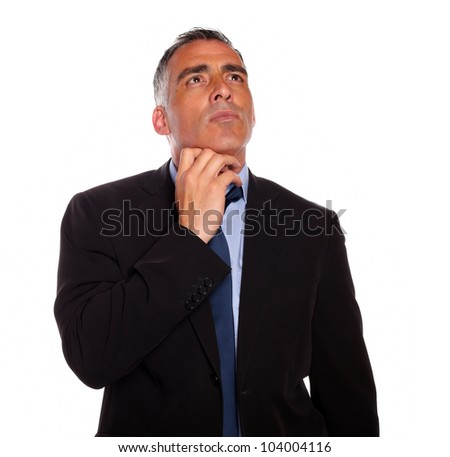 Portrait of a meditative businessman touching the chin while thinking on isolated background - stock photo