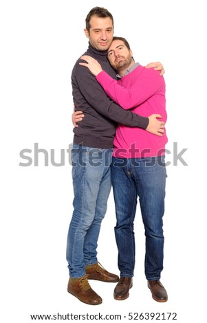 Portrait of a men gay couple in studio embracing each other