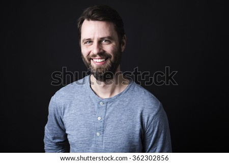 Portrait of a men with beard and mustache in studio black background - stock photo