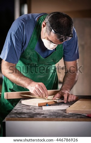 Portrait of a mid-adult craftsman working in his workshop.