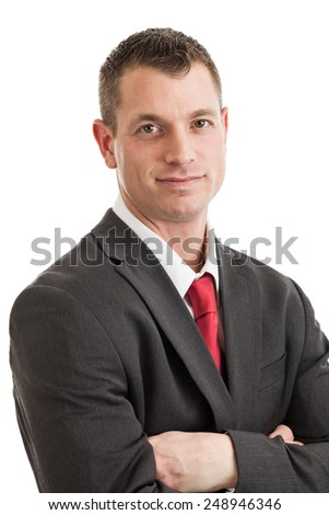 Portrait of a mid 30s buinessman wearing suit and tie isolated on a white background - stock photo