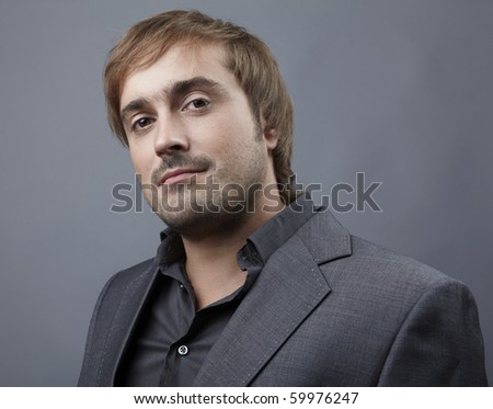 Portrait of a middle age businessman standing against isolated studio background - stock photo
