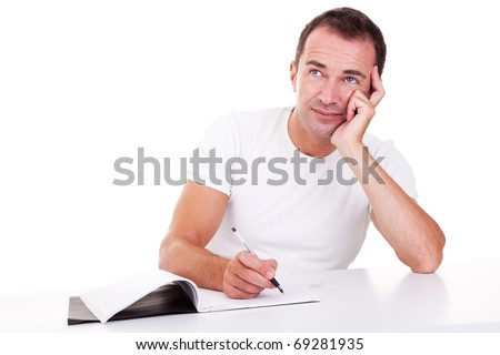 Portrait of a middle-age man thinking and writing, looking up, isolated on white. Studio shot - stock photo