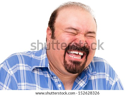 Portrait of a middle-aged Caucasian bearded happy man laughing loud, isolated on white background - stock photo