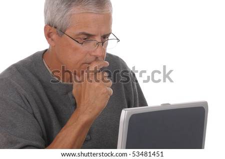 Portrait of a middle aged caucasian man looking at his laptop computer. Man is wearing casual attire with his hand on his chin. Close crop in horizontal format isolated on white. - stock photo