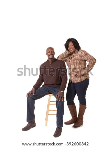 Portrait of a middle aged couple on white - stock photo