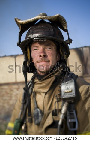 Portrait of a middle aged fire fighter - stock photo