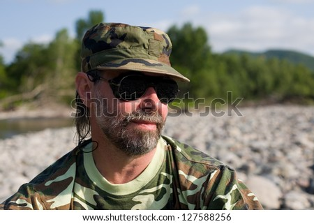 Portrait of a middle aged man having a rest on the outdoor. - stock photo