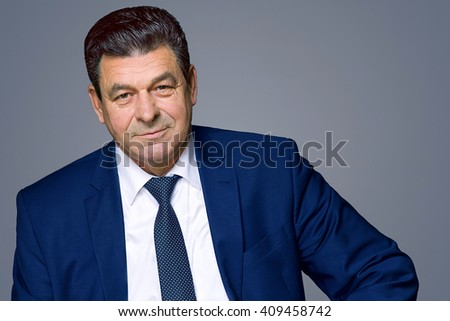 Portrait of a middle-aged man in a blue suit - stock photo